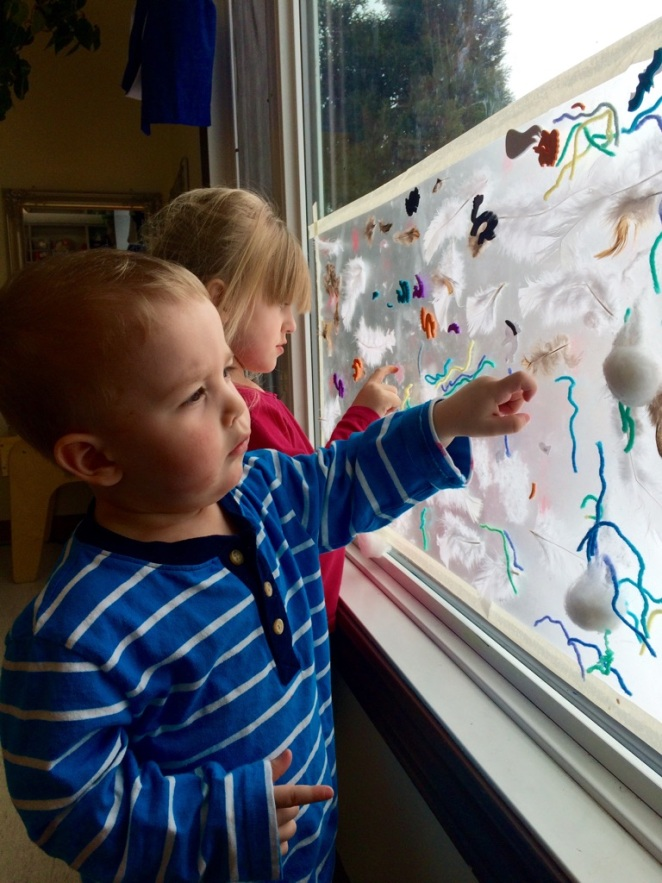 Some of our toddlers are exploring a sensory board, where they are able to touch and manipulate real life objects under close staff supervision. This is a great way for the children to process their world and environment.